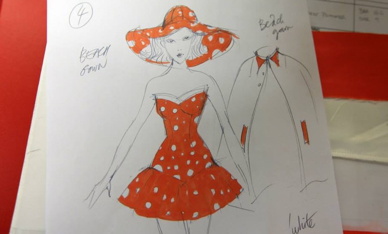 A sketch of a woman in a 1950s style orange polka dot bathing dress