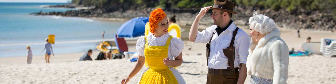 The cast of The Magic Flute on a beach in Noosa