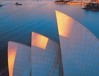 Sunlight beams onto the Sydney Opera House and Sydney Harbour at Sunset