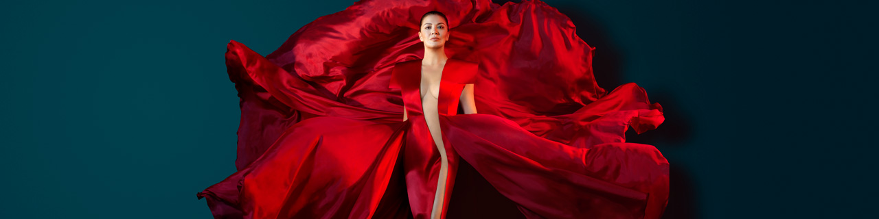 Milijana Nikolic stands in a red floating dress