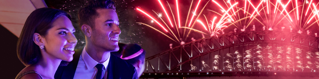 A couple enjoys the midnight fireworks over Sydney Harbour.
