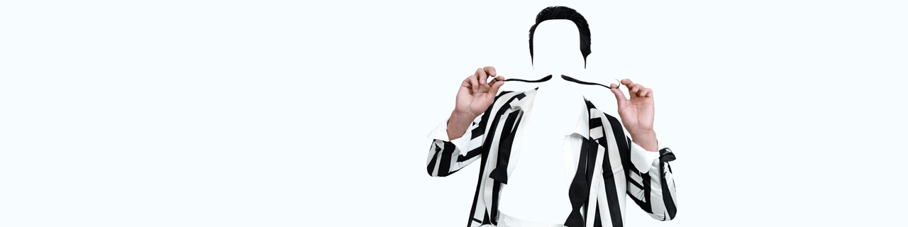 The barber of seville: a black and white striped jacket and mustache that curls up at the ends.