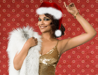 Danielle de Niese as the Merry Widow, with a Santa hat on.