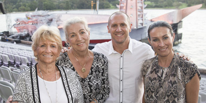 Larry Emdur and his family post in the grandstand at Opera on the Harbour high above the stage