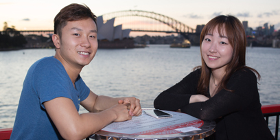 A couple sitting at Handa Opera on Sydney Harbour