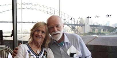 A couple enjoy a meal in the Northern Foyer bar, the Sydney Harbour bridge is behind them.