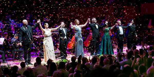 The stars of the Opera Gala take a bow on stage at the Sydney Opera House as confetti floats down to celebrate New Year's Eve