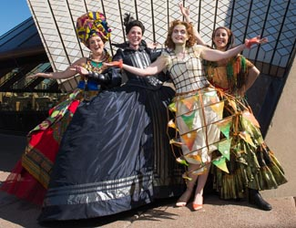 Four Opera Australia singers in costume outside the Sydney Opera House