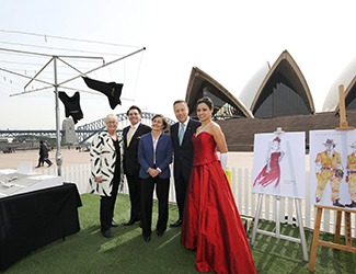 (L-R) Sandra Chipchase, Lyndon Terracini, Louise Herron, Craig Hassall and Stacey Alleaume stand in front of the Sydney Opera House Monumental Steps where Sydney Opera House — The Opera will be performed.