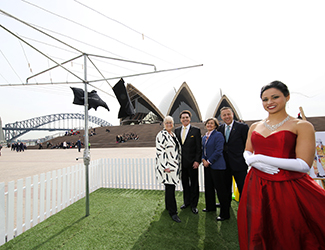 (L-R) Sandra Chipchase, Lyndon Terracini, Louise Herron, Craig Hassall stand in the backround, and Stacey Alleaume stands in foreground in front of the Sydney Opera House Monumental Steps.