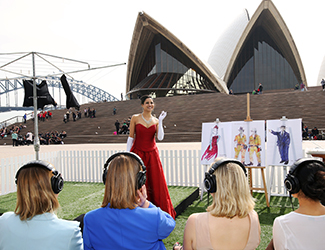 Soprano Stacey Alleaume performs for audience members wearing Audio Technica headphones like the ones that will be worn at Sydney Opera House — The Opera.
