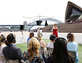 Soprano Stacey Alleaume performs for audience members wearing Audio Technica headphones like the ones that will be worn at Sydney Opera House — The Opera