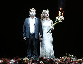Stefan Vinke as Siegfried, Lise Londstrom as Brünnhilde in Opera Australia's production of Götterdämmerung. Photo by Jeff Busby.