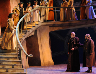Diego Torre as Gabriele Adorno, Natalie Aroyan as Amelia Grimaldi, Giacomo Presita as Jacopo Fiesco, George Patean as Simon Boccanegra and the Opera Australia Chorus in Opera Australia's production of Simon Boccanegra as Sydney Opera House.