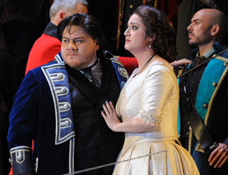 Diego Torre as Gabriele Adorno, Natalie Aroyan as Amelia Grimaldi and the Opera Australia Chorus in Opera Australia's production of Simon Boccanegra as Sydney Opera House.