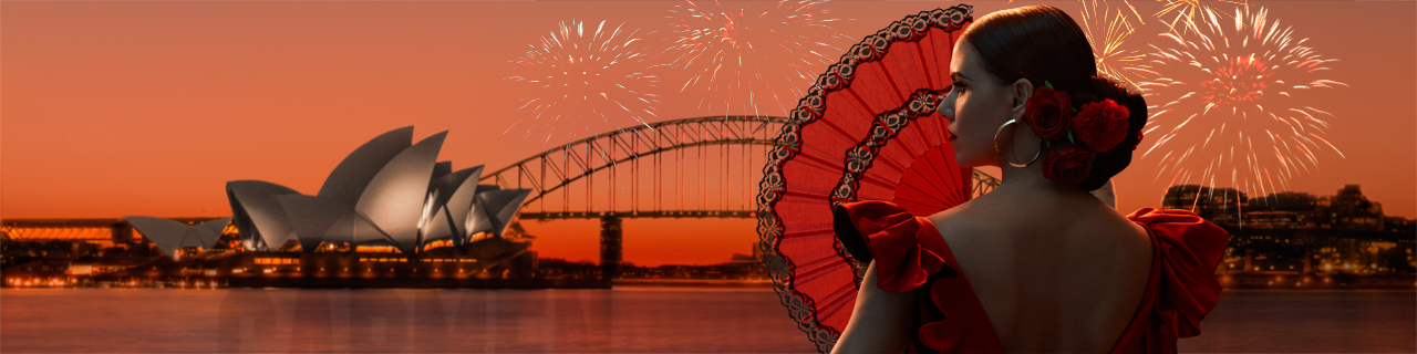 a woman in Spanish traditional dress holds a fan and looks coy against a backdrop of Sydney Harbour