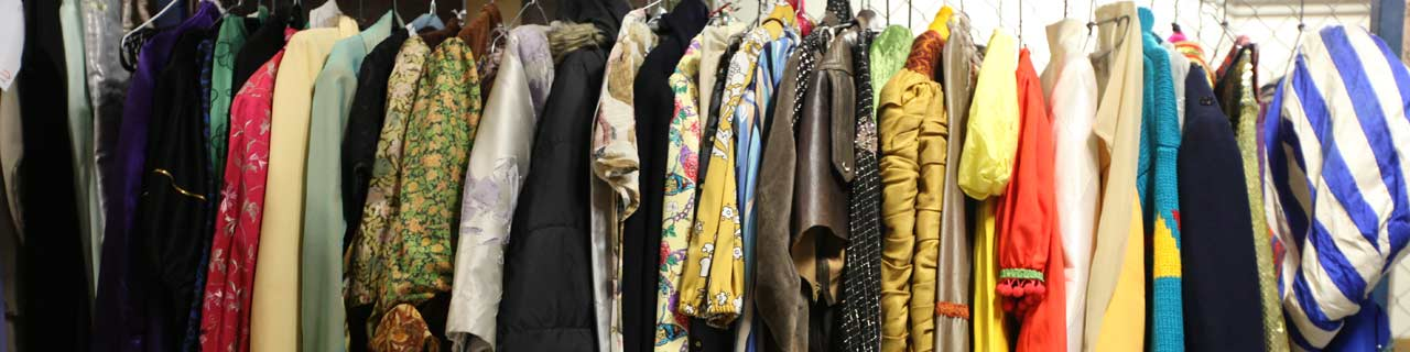 theatre costumes on a clothing rack