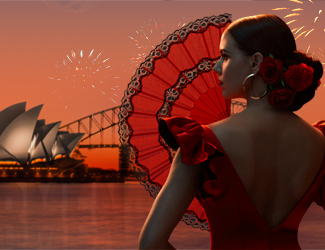 Sian Pendry, mezzo soprano in a red dress stands in front of Sydney Harbour.