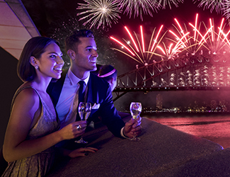 A couple watching the fireworks on New Years Eve from Sydney Opera House