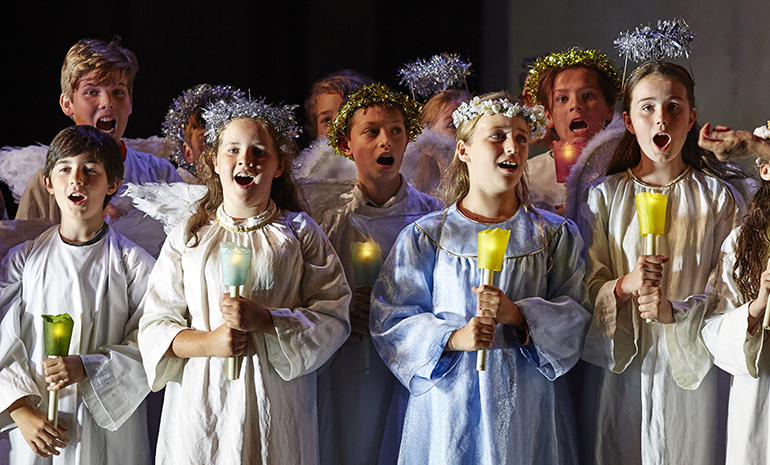 The Children's Chorus holding candles in the opera Cavalleria Rusticana and Pagliacci