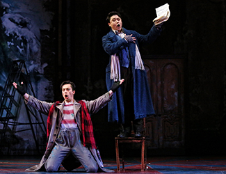 Christopher Tonkin as Marcello and Ji-Min Park as Rodolfo in Opera Australia's production of La Bohème. Photo by Prudence Upton