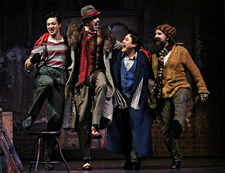 Christopher Tonkin as Marcello, Shane Lowrencev as Schaunard, Ji-Min Park as Rodolfo and Richard Anderson as Colline in Opera Australia's production of La Bohème. Photo by Prudence Upton