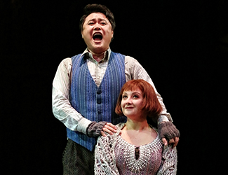 Ji-Min Park as Rodolfo and Mariangela Sicilia as Mimì in Opera Australia's production of La Bohème. Photo by Prudence Upton