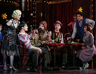 Taryn Fiebig as Musetta, Christopher Tonkin as Marcello, Richard Anderson as Colline, Shane Lowrencev as Schaunard, Ji-Min Park as Rodolfo, Mariangela Sicilia as Mimì and the Opera Australia Chorus in Opera Australia's production of La Bohème. Photo by Prudence Upton
