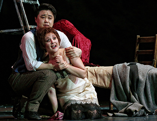 Mariangela Sicilia as Mimì and Ji-Min Park as Rodolfo in Opera Australia's production of La Bohème. Photo by Prudence Upton