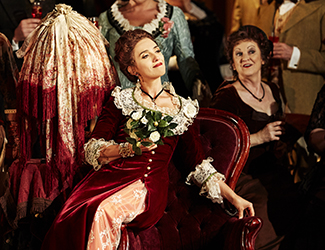 Ermonela Jaho as Violetta Valéry and the Opera Australia Chorus in Opera Australia's production of La Traviata. Photo by Keith Saunders