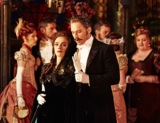 Ermonela Jaho as Violetta Valéry, Adrian Tamburini as Baron Douphol and the Opera Australia Chorus in Opera Australia's production of La Traviata. Photo by Keith Saunders