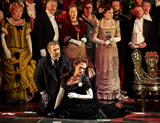 José Carbó as Giorgio Germont, Ermonela Jaho as Violetta Valéry and the Opera Australia Chorus in Opera Australia's production of La Traviata. Photo by Keith Saunders