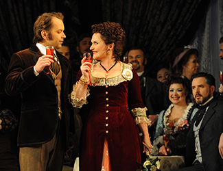 Arnold Rutkowski as Alfredo Germont & Emma Matthews as Violetta Valéry in Opera Australia's production of La Traviata. Photo by Branco Gaica