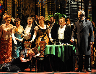 Emma Matthews as Violetta Valéry, Dominica Matthews as Flora Bervoix, Michael Honeyman as Marquis d'Obigny, José Carbó as Giorgio Germont and the Opera Australia Chorus in Opera Australia's La Traviata. Photo by Branco Gaica