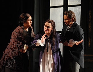 Natalie Aroyan as Annina, Emma Matthews as Violetta Valéry and Arnold Rutkowski as Alfredo Germont in Opera Australia's 2013 production of La Traviata. Photo by Branco Gaica