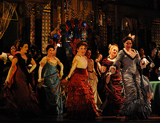 The Opera Australia Chorus in Opera Australia's La Traviata. Photo by Branco Gaica