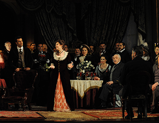 Lorina Gore as Violetta Valéry and the Opera Australia Chorus in Opera Australia's La Traviata. Photo by Branco Gaica