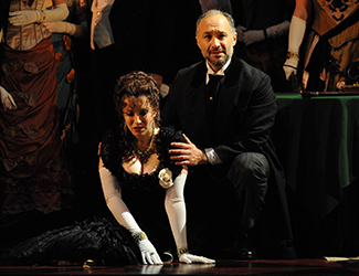 Lorina Gore as Violetta Valéry and José Carbó as Giorgio Germont in Opera Australia's La Traviata. Photo by Branco Gaica