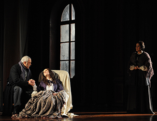 Gennadi Dubinsky as Doctor Grenvil, Lorina Gore as Violetta Valéry and Natalie Aroyan as Annina in Opera Australia's La Traviata. Photo by Branco Gaica