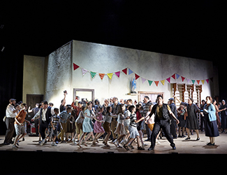 Diego Torre, the Opera Australia Children's Chorus and the Opera Australia Chorus in Pagliacci. Photo by Keith Saunders