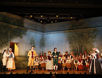Agnes Sarkis as Cherubino, Suzanne Shakespeare as Barbarina, Simon Meadows as Count Almaviva, Jenny Liu as Susanna, Adrian Tamburini as Figaro, Kristen Leich as Marcellina, Lee Abrahmsen as Countess Almaviva, Steven Gallop as Bartolo and the Geelong Youth Choir in Opera Australia's 2017 Regional Tour production of The Marriage of Figaro.
