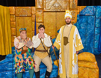 Raphael Wong as Papageno, Tomas Dalton as Tamino and Timothy Newton as Sarastro in Opera Australia's 2017 Schools Tour production of The Magic Flute. Photo by Albert Comper