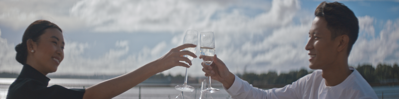 A man and woman drink champagne