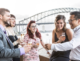 A group of friends drinking champagne on the balconies of the Northern Foyer before an opera performance.