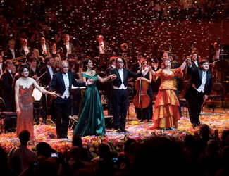 Opera performance forming a line on stage as confetti falls during the Opera Gala on New Year's Eve.