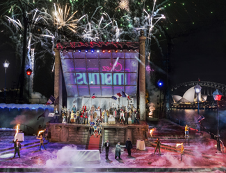 A stunning image of the production of La Boheme on Sydney Harbour with fireworks in the background.