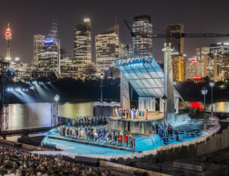 The set of La Boheme with the Sydney skyline in the background.