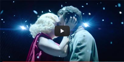 Lead characters Mimi and Rodolfo kissing in the trailer of La Bohème with a YouTube play button on it