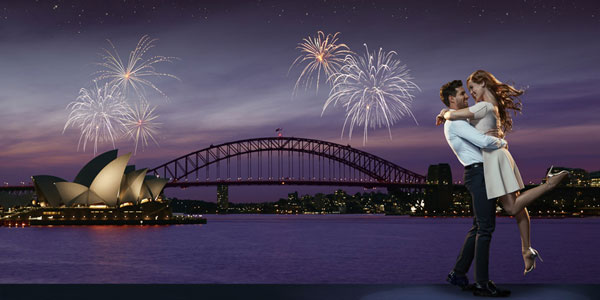 Fireworks explode against the Sydney harbour skyline, with a view of the Harbour Bridge and Sydney Opera House