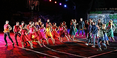 Dancers on the stage of West Side Story on Sydney Harbour